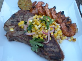 NEW YORK STRIP STEAK WITH GRILLED CORN RELISH AND PRAWNS